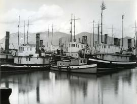 "Vessels crowded along dock, including the ""Jessie Mac"", the ""Stormking"",  and..."
