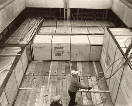 Workers loading crates for Vietnam