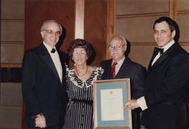 Unidentified couple receives certificate from Jewish National Fund
