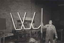 Ralph Blasberg constructs a Channuka Menorah at the Lubavitch Centre