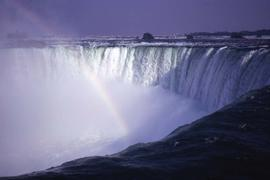 What is likely Niagara Falls with a rainbow through the centre
