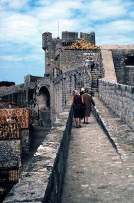 People walking on the city walls