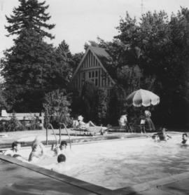 JCC Group - Unidentified people swimming in outdoor pool