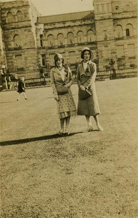 Two unidentified women in front of building