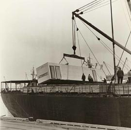 "Trailers for Atco Industries Ltd., Calgary, being moved onto MS ""American Oriole"""