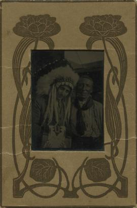Harry Seidelman wearing an Aboriginal headpiece and an unidentified man
