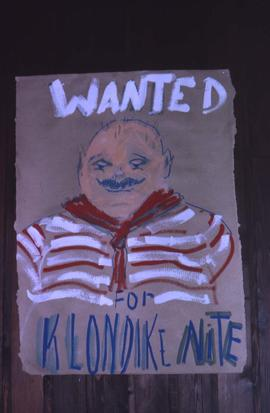 "Painting of a man with the words: ""Wanted For Klondike Nite"""