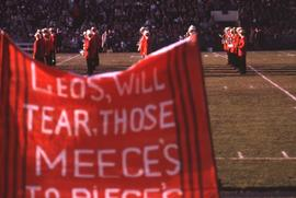 "Sign made out of orange material with black stripes and the words ""Leos, will tear, those Me..."