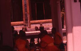 Buddhist worshippers sitting in a temple