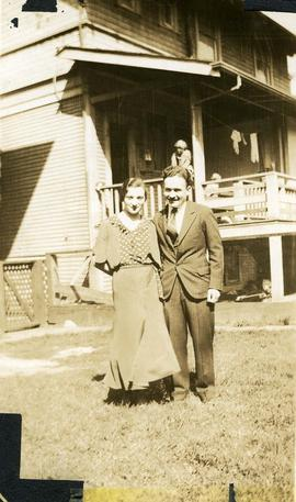 Esther Nemetz and Harry Nemetz [standing in front of a house]