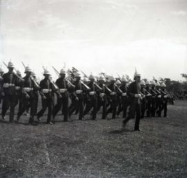 [Unidentified men, likely soldiers, marching with uniforms and weapons, possibly bayonets]