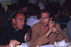 Two unknown men sitting at a table