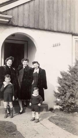Esther (left) and Esther's two sisters standing with Bill (left) and Perry (right) on a door...