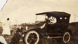 Unidentified man and woman in a car