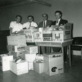 Members of Lion's Gate Lodge C. C. A. Committee prepare Chanuka hampers for the needy