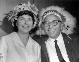 Woman and man wearing First Nations head dress, B'nai B'rith - Evergreen Lodge event