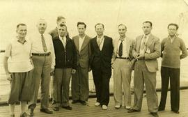 [Group of men on a boat deck]