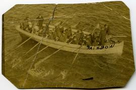 Harry Seidelman and a group of unidentified people rowing a boat