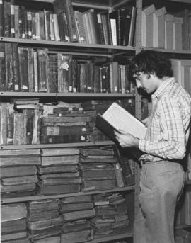 A researcher looks through one of the numerous old volumes housed in the Canadian Jewish Congress...