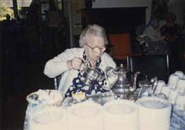 Becky Becker, a Ladies Auxiliary founder, does pouring honours at Pesach tea