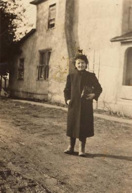 Rose Nemetz standing near a farm house
