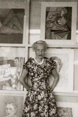 Bel Nemetz, her paintings in background