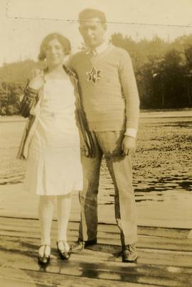[Unidentified woman and man wearing a Young Judaea sweater]