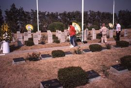 People walking through a cemetery