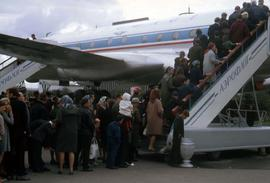 People lining-up for a tour of the inside of an airplane on display