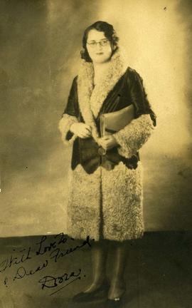 Dora Nesbit [posing in a jacket]