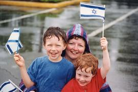 Walk with Israel [- Laurie Sheftel with her sons Benjamin and Jesse holding Israeli flags]