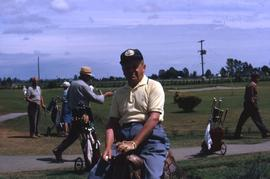 Unknown man sitting on a saddle on a golf course