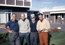 Four unknown men posing for the camera