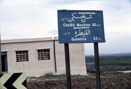 "Sign giving directions to ""Cheik Meskine 30 km"" and Quneitra 22 km"""