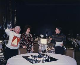 60th anniversary [- three unknown women standing behind a table]