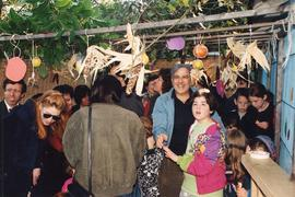 Group of people standing in sukkah