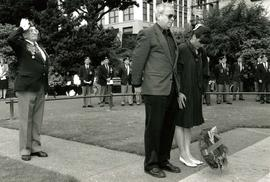 [Bernie Simpson and an unidentified woman at what appears to be a ceremony regarding the Second W...