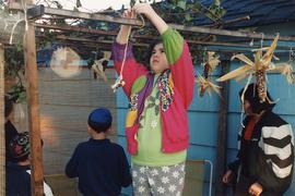 Children decorating sukkah