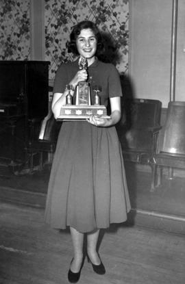 Young woman with trophy