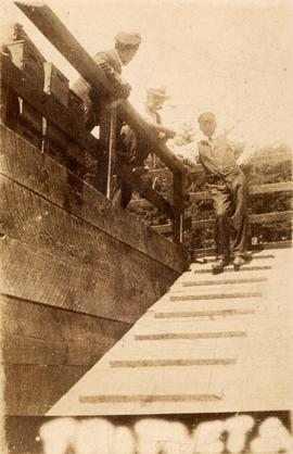 Unidentified men on gangway