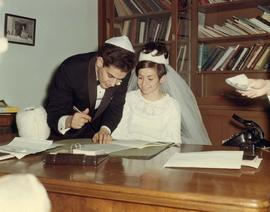[Shirley Barnett (nee Dayson) and Peter Barnett signing their wedding papers]