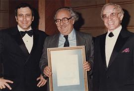 Unidentified man receives certificate from Jewish National Fund