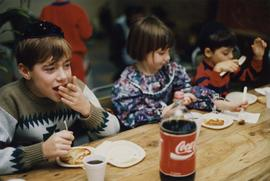 Children eating latkes