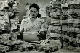 [Woman with notebooks]