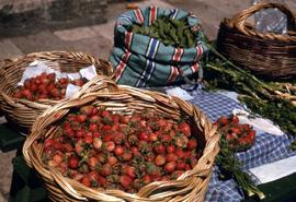 Strawberries in woven baskets among other produce at the Gunduliceva Poljana Market