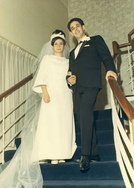 [Shirley Barnett (nee Dayson) and Peter Barnett posing on stairs]