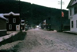 Street in Dawson City, including one of the buildings identifiable as the Bank of Montreal with t...
