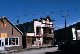 Few buildings in Dawson City, a clothing store and a lounge]