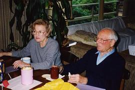 [Dr. Irving and Phyliss Snider sitting at a table]