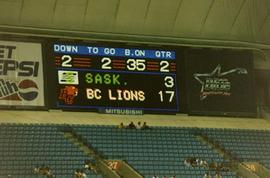 [BC Lions Scoreboard with blue bleachers below]